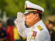 03 DECEMBER 2015 - BANGKOK, THAILAND: A Thai military officers salutes and swears allegiance to the King during the annual Trooping of the Colors parade at Sanam Luang in Bangkok. The Thai Royal Guards Parade, also known as Trooping of the Colors, occurs every December before the celebration of the birthday of Bhumibol Adulyadej, the King of Thailand. The Royal Guards of the Royal Thai Armed Forces perform a military parade and pledge loyalty to the monarch. Historically, the venue has been the Royal Plaza in front of the Dusit Palace and the Ananta Samakhom Throne Hall. This year it was held on Sanam Luang in front of the Grand Palace.    PHOTO BY JACK KURTZ
