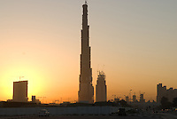 Burj Khalifa at sunrise designed by Skidmore, Owings, Merrill architecture firm aka SOM. Dubai, one of the seven emirates and the most populous of the United Arab Emirates sits on the southern coast of the Persian gulf.