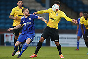 Dover Athletic forward Jamie Allen (10) and FC Halifax Town midfielder Niall Maher (31) battle for the ball during the Vanarama National League match between FC Halifax Town and Dover Athletic at the Shay, Halifax, United Kingdom on 17 November 2018.