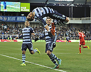 Sporting KC forward Dominic Dwyer (14) celebrates after scoring on a penalty kick against the San Jose Earthquakes during the second half at Sporting Park.