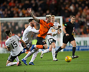 30th November 2018, Tannadice Park, Dundee, Scotland; Scottish Championship football, Dundee United versus Ayr United; Fraser Aird of Dundee United is brought down by Daniel Harvie of Ayr United