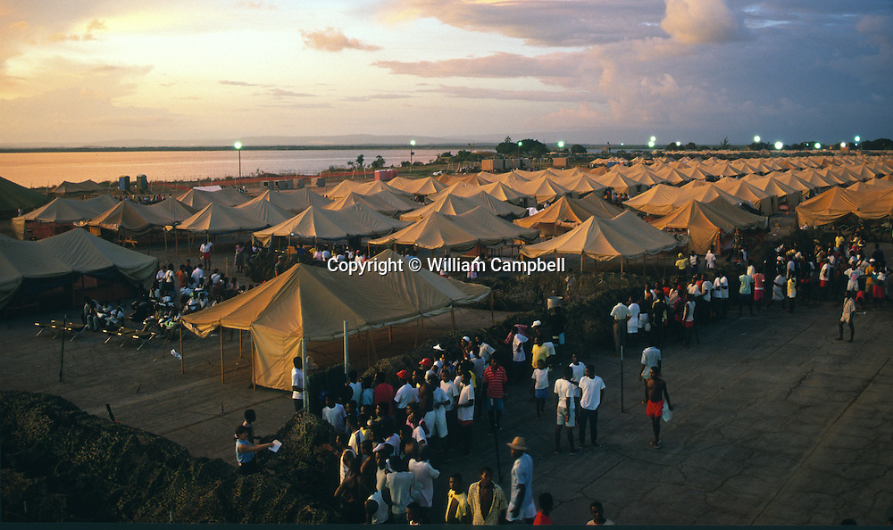 "Haitian refugees held at Guantanamo Bay Naval Station 9/27/94Haitian refugees held at Guantanamo Bay Naval Station 9/27/94Haitian refugees held at Guantanamo Bay Naval Station 9/27/94.Haitian refugees at Camp Buckley at the Guantanamo Bay Naval Station in Cuba 1991. Thousands of Haitian refugees heading to the US were stopped at sea and taken to GTMO as part of ""operation Safe Haven."""