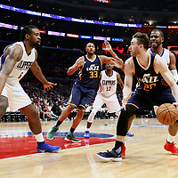 25 March 2016: LA Clippers center DeAndre Jordan (6) and LA Clippers guard Chris Paul (3) defend on Utah Jazz forward Gordon Hayward (20) during the Los Angeles Clippers 108-95 victory over the Utah Jazz, at the Staples Center, Los Angeles, California, USA.