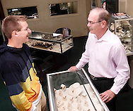Andrew Hungler, 17 of Centerville (left) talks with Jim Pridgen at Pridgen Jewelers in Centerville, Ohio, Saturday, August 25, 2012.