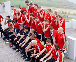 DINARD, FRANCE - Tuesday, June 7, 2016: Wales players rub their eyes after they have posed for a team group photograph at the Novotel Thalasso Dinard ahead of the start of the UEFA Euro 2016 tournament. Back row L-R: Ashley 'Jazz' Richards, Emyr Huws, Paul Dummett, James Chester, Simon Church, George Williams, Jonathan Williams, David Vaughan. Middle row L-R: Andy King, James Collins, goalkeeper Daniel Ward, goalkeeper Wayne Hennessey, goalkeeper Owain Fon Williams, Sam Vokes, David Edwards, Ben Davies, David Cotterill. Front row L-R: Neil Taylor, Hal Robson-Kanu, Joe Ledley, Gareth Bale, goalkeeping coach Martyn Margetson, assistant manager Osian Roberts, manager Chris Coleman, coach Paul Trollope, captain Ashley Williams, Aaron Ramsey, Joe Allen. (Pic by Paul Greenwood/Propaganda)