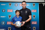 mascot and AFC Wimbledon goalkeeper Joe McDonnell (24) during the EFL Sky Bet League 1 match between AFC Wimbledon and Portsmouth at the Cherry Red Records Stadium, Kingston, England on 13 October 2018.