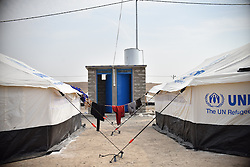 New tents and toilets in the refugees camp of UNHCR in Zelican, North of Mosul, Kurdistan Region of Iraq on October 25, 2016. UNHCR is stepping up its preparations to receive those displaced by the fighting to retake Iraqís second city, Mosul. Photo by Mathieu Redoube/ABACAPRESS.COM