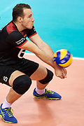 Poland, Krakow - 2017 September 03: Denys Kaliberda from Germany receives the ball while final match between Germany and Russia during Lotto Eurovolleyball Poland 2017 - European Championships in volleyball at Tauron Arena on September 03, 2017 in Krakow, Poland.<br /> <br /> Mandatory credit:<br /> Photo by &copy; Adam Nurkiewicz<br /> <br /> Adam Nurkiewicz declares that he has no rights to the image of people at the photographs of his authorship.<br /> <br /> Picture also available in RAW (NEF) or TIFF format on special request.<br /> <br /> Any editorial, commercial or promotional use requires written permission from the author of image.