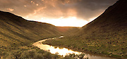 Idaho. South Fork Owyhee, Canyonlands,  River. Sunset after clearing storm.
