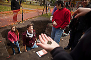 (Cambridge, MA - October 29, 2009)  Harvard University President Drew Faust visits the Yard Dig outside her offices at Massachusetts Hall.   Daniel Balmori '11, center in the pit, smiles as others look at a relic he just found in the plot he was working on.  Staff Photo Justin Ide/Harvard University News Office