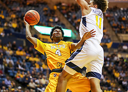 Nov 24, 2018; Morgantown, WV, USA; Valparaiso Crusaders guard Bakari Evelyn (4) shoots in the lane while defended by West Virginia Mountaineers forward Emmitt Matthews Jr. (11) during the first half at WVU Coliseum. Mandatory Credit: Ben Queen-USA TODAY Sports