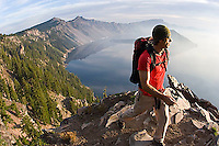 Young man hiking at Crater Lake National Park, Oregon<br />