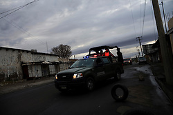 Police in Ciudad Juarez, Mexico patrol the town looking for drugs and weapons.  Mexico is undergoing a violent war with the nation's drug cartels and Ciudad Juarez has become the murder capital of Mexico, with over 4,000 murders in the past two years.  President Felipe Calderon has dispatched thousands of soldiers and federal police officers in order to contain the situation, but they have not been successful.