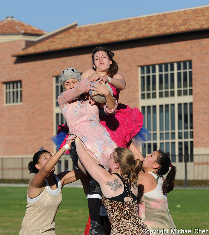 Fourth-year economics and global studies student Sonia Globerson-Lamb (top) of the Bruin Rangers pulls down the ball following a line-out in the annual Prom Dress Rugby fundraiser game on the UCLA Intramural Field in Los Angeles. on Thursday, Jan. 8, 2009.  UCLA women's rugby has enjoyed 31 years of excellence.