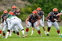 KELOWNA, BC - SEPTEMBER 22: JJ Heaton #62 and Karn Sidhu #95 of Okanagan Sun block Tyson Spence #90 of Valley Huskers at the Apple Bowl on September 22, 2019 in Kelowna, Canada. (Photo by Marissa Baecker/Shoot the Breeze)