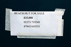 © Licensed to London News Pictures. 01/07/2016. Brighton, UK. A beach hut on the Brighton and Hove seafront is advertised for sale. Beach huts in the seaside resort sell for in excess of 25K. Photo credit: Hugo Michiels/LNP