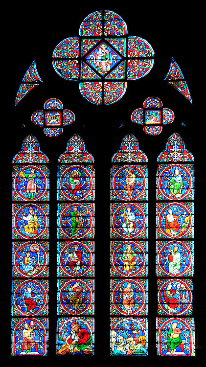 Ornate stained glass window in Notre Dame de Paris Cathedral