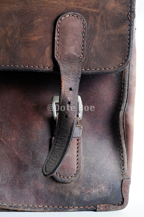 buckle and strap on old leather briefcase