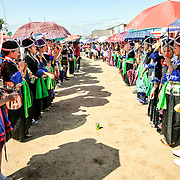 Ball games at the New Year celebration in Phonsavan. Young Hmong men and women flock to the New Year festival in in Phonsavan in northeastern Laos. Hmong girls dress in brightly colored costumes and engage ball games of catch as part of a ritual traditionally designed to find husbands. The people of the region are predominantly of Hmong ethnicity.