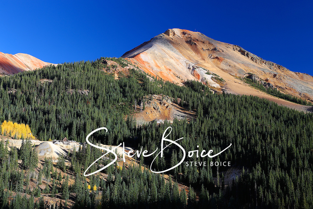 Red Mountain Pass near Silverton, Colorado during autumn with yellow aspen leaves and blue sky