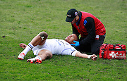 Anthony Watson receives treatment after being injured. Stade Toulousain v Bath, European Champions Cup 2015, Stade Ernest Wallon, Toulouse, France, 18th Jan 2015.