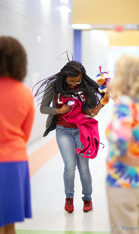 Last day of school at Ronald E. McNair Elementary School<br /> <br /> Teacher Janay Barnes celebrates the end of school with a dance in the hall.<br /> <br /> Photographed, Tuesday, June 12, 2018, in Greensboro, N.C. JERRY WOLFORD and SCOTT MUTHERSBAUGH / Perfecta Visuals