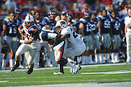 Ole Miss' Ja-Mes Logan (85) is tackled by Southern Illinois cornerback James McFadden (24) at Vaught-Hemingway Stadium in Oxford, Miss. on Saturday, September 10, 2011. Ole Miss won 42-24.