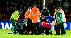 STEVENAGE, ENGLAND - Saturday, January 25, 2014: Everton's Bryan Oviedo lies injured as team-mates look on concerned during the FA Cup 4th Round match against Stevenage at Broadhall Way. (Pic by Tom Hevezi/Propaganda)
