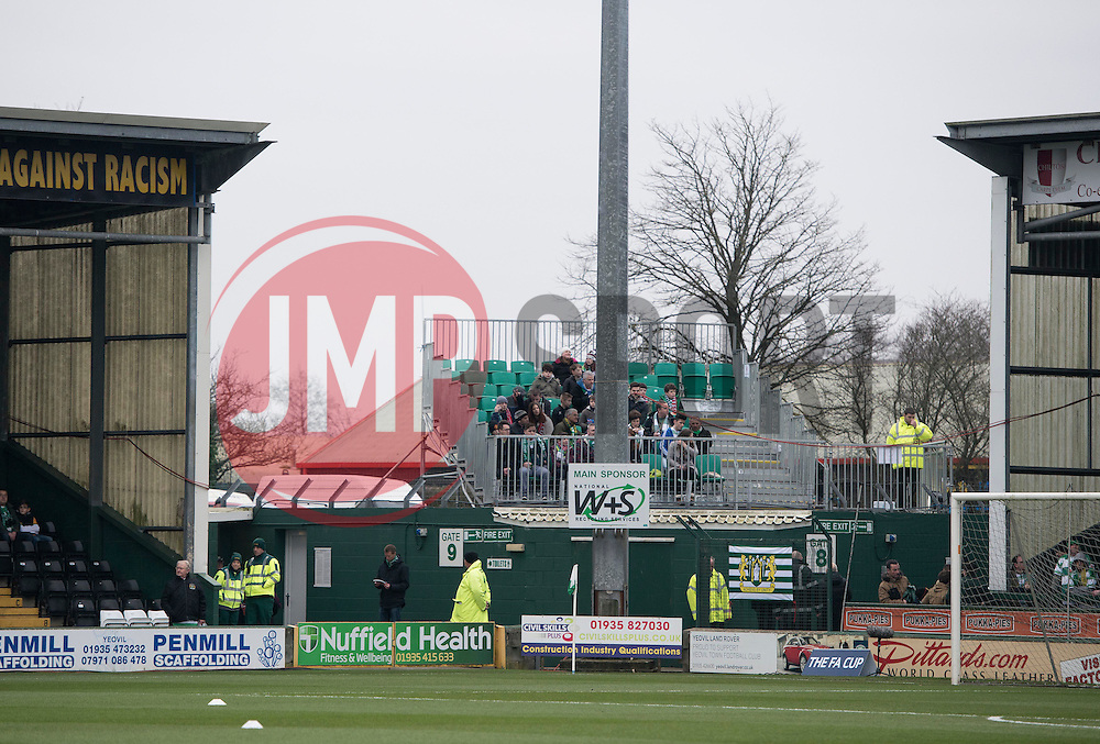 Fans watch from a temporary stand  - Photo mandatory by-line: Joe meredith/JMP - Mobile: 07966 386802 - 04/01/2015 - SPORT - football - Yeovil - Huish Park - Yeovil Town v Manchester United - FA Cup - Third Round