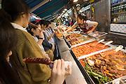 Myeong-dong shopping district. Korean snacks.