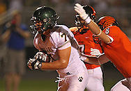 Kennedy's Drew Heitland (7) runs into the end zone for a touchdown as Prairie's Mitchell Dellamuth (7) and Coen Brown (8) give chase during their game at John Wall Memorial Stadium at Prairie High School in Cedar Rapids on Friday, September 6, 2013.