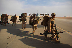 August 22, 2017 - (FILE PHOTO) - US President Donald Trump has announced he would prolong the US military intervention in Afghanistan. PICTURED: Oct. 27, 2014 - Camp Leatherneck, Helmand Province, Afghanistan - At Bastion Airfield in Helmand Province, some of the last Marines left on Camp Leatherneck earlier handed over their guard post to their Afghan National Army counterparts and now board C-130 for the official withdrawal of U.S. Marines from Helmand Province. (Credit Image: © Nelvin C. Cepeda/U-T San Diego/ZUMA Wire)