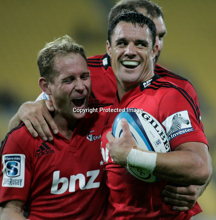 Hurricanes 29 V Crusaders 28-Westpac Stadiu.8 3.2013 Dan Carter celebrates second half try  with halfback Andy Ellis.bush pic.3