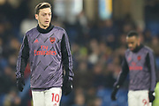Arsenal midfielder Mesut Özil (10), warming-up, before the Premier League match between Chelsea and Arsenal at Stamford Bridge, London, England on 21 January 2020.
