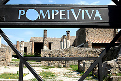 The city of Pompeii is a partially buried Roman town-city near modern Naples in the Italian region of Campania, in the territory of the comune of Pompei. Along with Herculaneum, Pompeii was destroyed and completely buried during a long catastrophic eruption of the volcano Mount Vesuvius spanning two days in the year AD 79. The eruption buried Pompeii under 4 to 6 m (13 to 20 ft) of ash and pumice, and it was lost for nearly 1700 years before its accidental rediscovery in 1749. Since then, its excavation has provided an extraordinarily detailed insight into the life of a city at the height of the Roman Empire. Today, this UNESCO World Heritage Site is one of the most popular tourist attractions of Italy, with approximately 2,500,000 visitors every year.