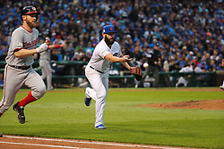 October 11, 2017 - Chicago, IL, USA - The Washington Nationals' Stephen Strasburg, left, runs down the first base line after a successful sacrifice bunt in the fourth inning, as Chicago Cubs pitcher Jake Arrieta tosses him out in Game 4 of the National League Division Series at Wrigley Field in Chicago on Wednesday, Oct. 11, 2017. (Credit Image: © Brian Cassella/TNS via ZUMA Wire)