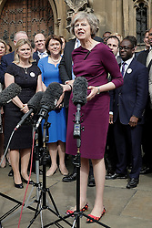 ©  London News Pictures. 07/07/2016. London, UK. Conservative Party leadership candidate and current home secretary THERESA MAY is joined by supporting MP's as she speaks outside Parliament  following  this afternoon's second round of voting for the leadership of Conservative party.  Photo credit: Peter Macdiarmid/LNP