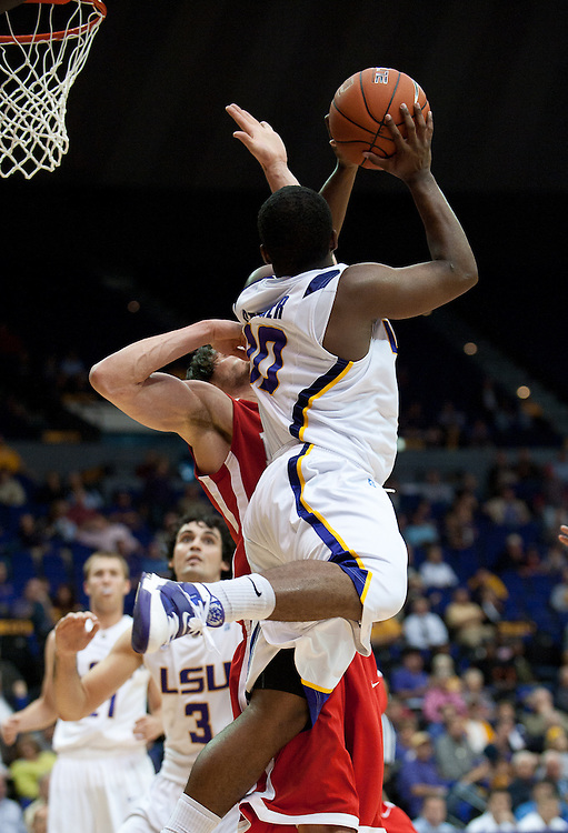 LSU Tigers guard Andre Stringer (10) shoots a basket during the second half of the game. Nicholls State Colonels defeated LSU 62-53.