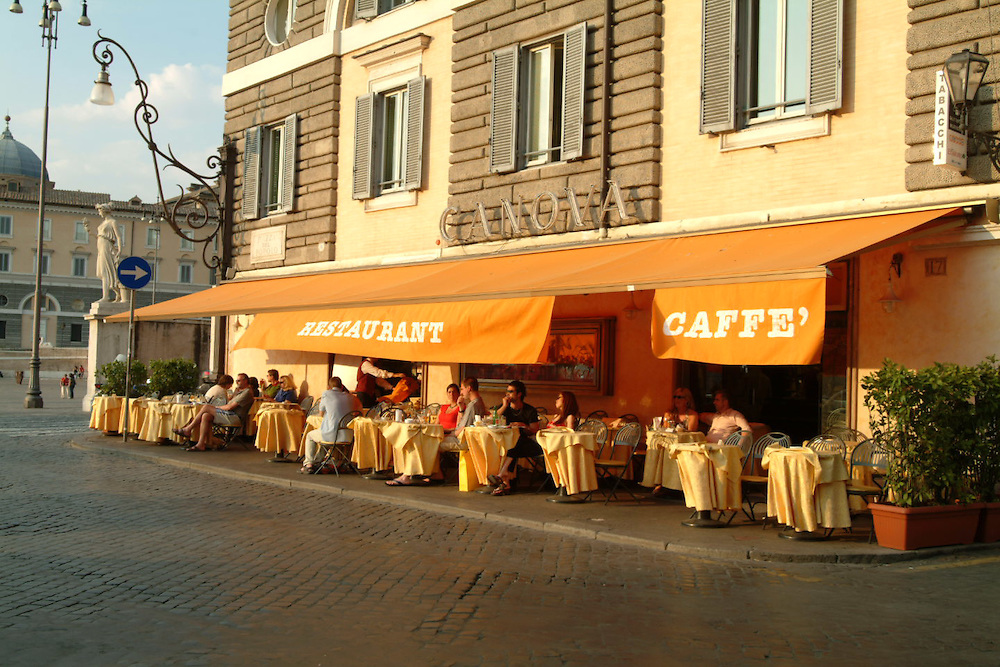 Street cafe with tourists in Rome, Italy