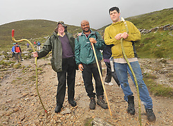 Despite the cancellation notices Basil Finan Roscommon, Christopher Igwilo Longford and Nigeria and Alex Pocci from Chicago USA, were amoung the many pilgrims that continued to the summit of Croagh Patrick on reek sunday .<br /> Pic Conor McKeown