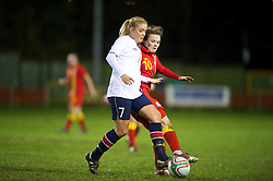 NEWTOWN, WALES - Friday, February 1, 2013: Wales' Ellie Curson in action against Norway's Marit Sandtroen during the Women's Under-19 International Friendly match at Latham Park. (Pic by David Rawcliffe/Propaganda)