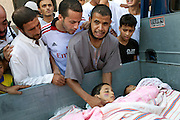 22 august 2011. People from the Gorji area in Tripoli mourn two children killed by snipers during the day after the rebels enter in Tripoli.