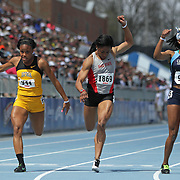 KIMPEL, DOMINIQUE - DRAKE RELAYS, 2013 - Iowa Central's Dominique Kimpel, right, edged Ohio State's Ashlee Abraham, (3rd) and Iowa's Lake Kwaza in 11.55 in the University Women's 100.  photo by David Peterson