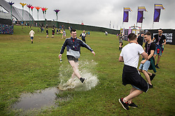 © Licensed to London News Pictures . 11/06/2016 . Manchester , UK . A reveller splashes through a water puddle at the Parklife music festival at Heaton Park in Manchester . Photo credit : Joel Goodman/LNP