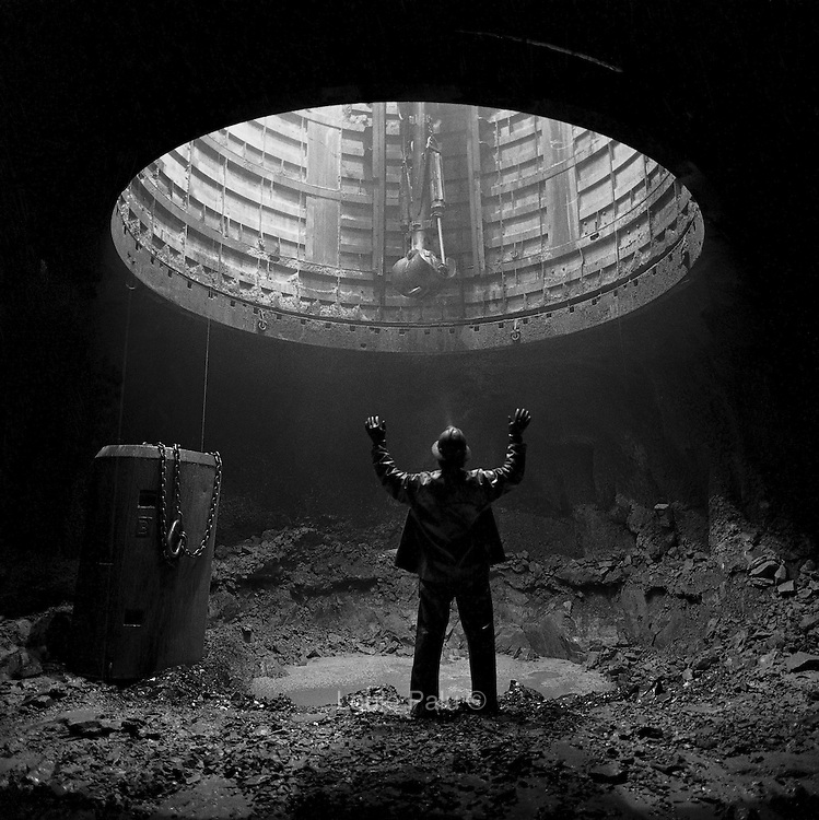 Shaft miner at the 2500 foot level station before mucking and drilling, Louvicourt Mine, Val d?Or, Quebec. From the book Cage Call: Life and Death in the Hard Rock Mining Belt. An in-depth project spanning over 12-years examining communities in one of the richest mining regions in the world located in Northwestern Ontario and Northeastern Quebec in Canada.