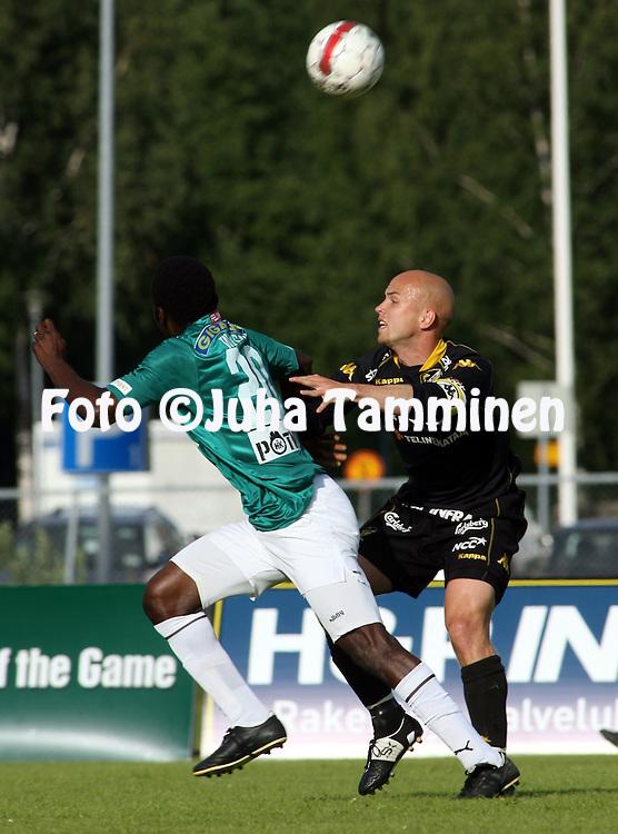 06.07.2009, Tapiolan Urheilupuisto, Espoo, Finland..Veikkausliiga 2009 - Finnish League 2009.FC Honka - FC TPS Turku.Rami Hakanp?? (Honka) v Babatunde Wusu (TPS).©Juha Tamminen.