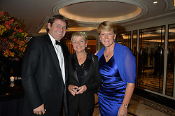 Left to right, CHARLIE BROOKS, ALICE ARNOLD and CLARE BALDING at the 26th Cartier Racing Awards held at The Dorchester, Park Lane, London on 8th November 2016.