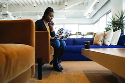 January 14, 2020, USA: Shaniqua Davis, who runs a new business Noirefy, which helps companies look for job candidates from diverse backgrounds, gets some work done on her laptop Jan. 6, 2020, at a WeWork co-working space in Chicago. (Credit Image: © TNS via ZUMA Wire)
