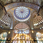 Inside Instanbul's spectacular Blue Mosque. Sultan Ahmed Mosque (Turkish: Sultanahmet Camii) known popularly as the Blue Mosque is a Muslim (Sunni) Mosque in the center of Istanbul's old town district of Sultanahmet. It was commissioned by Sultan Ahmed I and completed in 1616,