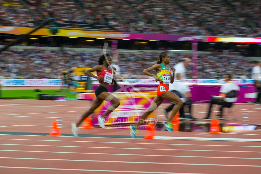 London, August 13 2017 . Almaz Ayana, Ethiopia, and Hellen Onsando Obiri, Kenya, lead the women's 5000m final on day ten of the IAAF London 2017 world Championships at the London Stadium. © Paul Davey.